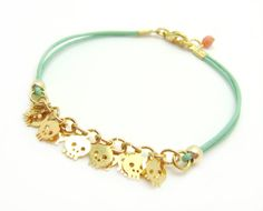Tiny Skull Bracelet - Pastel Mint Leather W/ Tiny Gold Plated Skulls - Coral faceted pendant