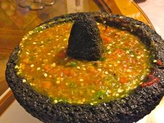 This salsa molcajeteada combines pan roasted tomatoes, garlic, and peppers to make a spicy and hearty salsa. They are pureed in a molcajete.