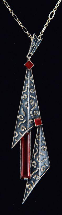 Theodor Fahrner - An Art Deco silver, enamel and carnelian pendant, Pforzheim, 1928-30. 11.2 x 2.6 cm. Marked: TF 935. #Fahrner #ArtDeco #pendant