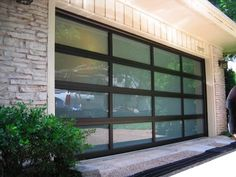 mid century modern garage doors | glass garage doors look so much better than standard garage doors ...
