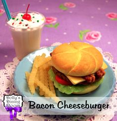 Enjoy this totally sublime flame-grilled hamburger on a homemade artisan bun with lettuce, tomatoes, cheddar cheese, and of course, BACON! It'll make any day feel like a hot summer barbecue in your own backyard. Served with a pile of crispy fries and a frosty vanilla shake with whipped cream, sprinkles, and a cherry on top. OH YEAH!