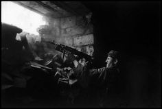 Chechnya, 1996 - Chechen rebel fighting along the front line against the  Russian army.