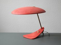 Very rare Italian Mid Century modernist table lamp with red shrink varnish