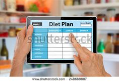 Hands with Tablet Using Diet Plan App in front of open fridge or refrigerator