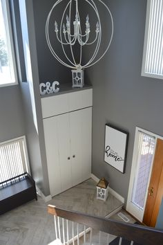 Entry Way First impressions! Homemade chandelier for under $200. Herringbone tile floor. DIY. It's so good to be home