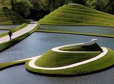 Garden of Cosmic Speculation at the Portrack House, Dumfries Scotland.apparently only open to the public one day a year. By landscape architect and theorist Charles Jencks. Might take some major planning but I got see it someday ! Landscape Architecture Design, Green Architecture, Classical Architecture, Ancient Architecture, Sustainable Architecture, Installation Architecture, Parks, Modern Landscaping, Garden Landscaping