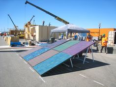 Students from Southern California Institute of Architecture and California Institute of Technology are using a PV system to power all their electricity needs during assembly. Their goal is to be completely renewable, including during construction on the competition site. #SD2013