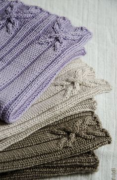 Ravelry: Cable Cowl and Hat pattern by Foldi knit - I like the cable pattern on this. The pattern comes with kids' hats patterns as well, including ear flaps.