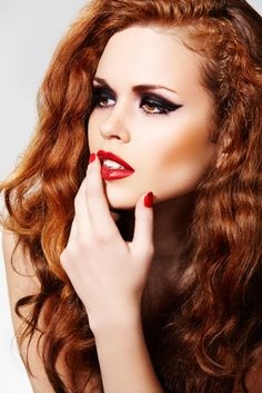 amber hair & eyes, red lips & nails, winged eyeliner