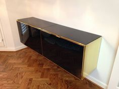 Gold Credenza | Floating Black and Gold Ello Credenza at 1stdibs