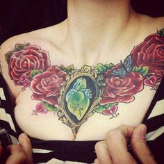 Love this flowers & heart chest piece. No artist info.