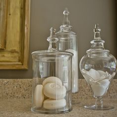 Trendy And Cool Transparency On Soap Jars As Storage And Decorative Idea Of Master Bathroom Renovation Interior