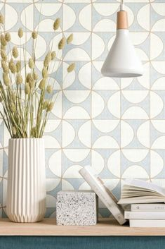 Make a statement with this chic, geometric two-tone design; showcasing contemporary semicircles in a uniform pattern. Seen here in the Duck Egg colourway. See the complete collection now live on wallpaperdirect Family Apartment, York Apartment, Old Suitcases, Modern Coastal, Blue Wallpapers, Vintage Children, True Colors, Small Spaces, Accent Chairs