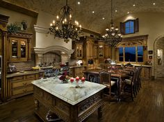 Custom Kitchen with an arched tiled ceiling. The custom cabinetry includes two islands (one for dinning and one for preparation)  both with chandeliers for intimate lighting.