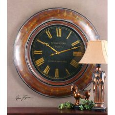 Decora Tyrell Clock - Distressed walnut brown finish with gold undertones and light gray wash. Aged black clock face with antiqued gold numbers under glass. Quartz movement.  - See more at: http://decora.nonnihome.com/wall-clocks/380189049-decora-tyrell.html#sthash.8WGxu6RN.dpuf