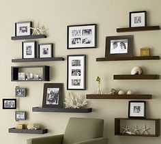 Use of hanging pictures in the middle helps break things up.