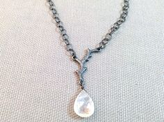 Handmade Silver Necklace with rainbow moonstone, oxidized branch.   Necklace measures up to 17 inches and has a lobster clasp closure. Handmade by Evan Knox in her Brown County Studio. All of our jewelry comes boxed and ribboned, ready for giving (or keeping)!