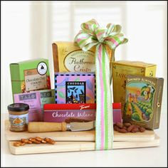 Springtime Cheeseboard This springtime gourmet meat and cheese assortment is a delectable gift packed with savory delights! Gourmet goodies are beautifully presented upon a wooden cutting board. $39.99