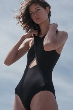 From the online exclusive swimwear collection, a modern and sleek one piece swimsuit with wrapping top straps, front and back cut out detail and medium back coverage. Sassen Maillot features seamless