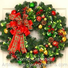 Holly Jolly Christmas Wreath - 2015 - A beautiful traditional Christmas Wreath with reds and greens highlighted with Holly and a lovely bow. #HollyWreath