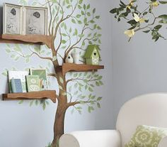 I love the use of shelves in this tree mural! For a garden themed room, it's a cool idea, although I'd want to add some color and whimsy to the tree.