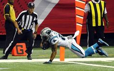 Carolina Panthers strong safety Kurt Coleman (20) dives in for a touchdown after an interception against the Atlanta Falcons in the first half at the Georgia Dome in Atlanta, Ga. on Sunday, October 2, 2016.
