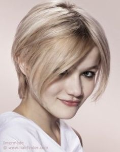 Blonde pixie cut with a middle part.