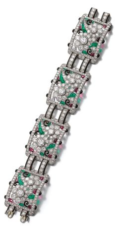 An Art Deco gem set, enamel and diamond bracelet, 1930s. Designed as a series of openwork plaques decorated with floral motifs, each set with cabochon amethysts and emeralds, circular- and single-cut diamonds, highlighted with black enamel, numbered, French assay and maker's marks, fitted case stamped Drayson. #ArtDeco #bracelet