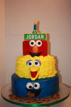 I think I found his birthday cake! Very cute!  Elmo with the Count, and Big Bird with Ernie... and Cookie Monster with Grover.  :)