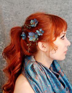 Ever think that just a small touch of nature, flowers-per-say could really do up your look? This is one gorgeous style. Try it sometime, with any flower in particular, and get creative with it. Add a braid or two and see how far you can go, and get noticed. Thanks etsy.com