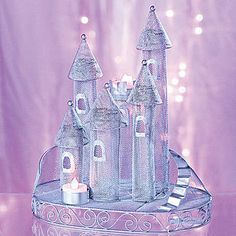 Our silver Fairytale Castle Centerpiece will create a magical fairytale feel. The mesh castle centerpiece measures 12 1/2 inches high x 7 inches wide and is made of metal.
