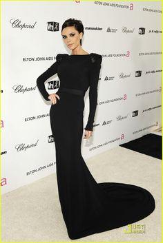 Victoria Beckham in Victoria Beckham black dress with a train