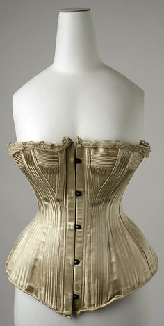 """1890s """"wedding corset"""", silk. Like this a lot. Like the more muted, almost """"putty"""" colour to the silk."""