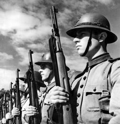 Brazilian soldiers of the Brazilian Coast Artillery stand at attention at Fort Copacabana. Brazil joined the Allies and declared war on the Axis on 22 August 1942 and was the only independent South American country to send ground troops to fight in the Second World War. Fort Copacabana, Rio de Janeiro, Brazil. 16 September 1943.