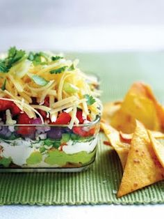 Mexican Layer Dip  2 large alvacados  2 tablespoons lemon juice  1/2 teaspoon salt  1/4 teaspoon pepper  1 1/2 cups sour cream  1 package taco seasoning mix  1 can refried beans  1/4 cup taco sauce  8 grn onions chopped  2 med tomatoes chopped  1 (4 1/2-ounce) black olives chopped  2 cups shredded cheese  Mash avocados with lemon juice, salt and pepper; set aside. Combine sour cream and taco seasoning mix; set aside. Mix refriend beans and taco sauce.