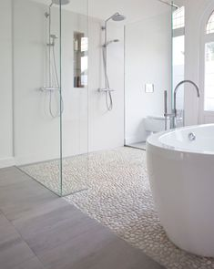 Shower Floor   Modern Bathroom Features A Crystal Chandelier Free Standing  Acrylic Tub A Mix Of Marble Tile And Pebble Floor And A Double Shower With  Custom ...