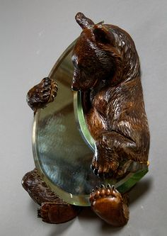 rare carved wood bear holding a moon shaped mirror, swiss brienz 1900