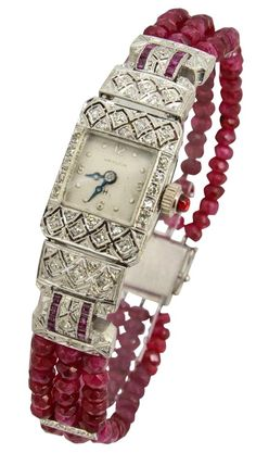 Hamilton Lady's Platinum, Diamond and Ruby Bracelet Watch on Ruby Beads. Finely made Deco watch featuring a geometric filigree design with diamonds and channel set rubies. A contemporary ruby bead band with diamond spacers and a new clasp has been added t Bijoux Art Deco, Art Deco Jewelry, Fine Jewelry, Jewelry Design, Beaded Jewelry, Ruby Bracelet, Bracelet Watch, Bracelets, Antique Watches