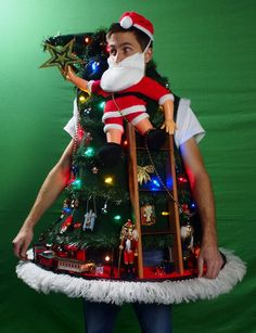 Santa Climbing The Tree ugly sweater 15 DIY Ugly Christmas Sweaters you can make! Get creative and make your own Ugly Christmas Sweater with these 15 tacky Christmas Sweaters ideas! Ugliest Christmas Sweater Ever, Diy Ugly Christmas Sweater, Christmas Jumpers, Xmas Sweaters, Tacky Sweater, Tacky Christmas Party, Christmas Costumes, Christmas Humor, Diy Christmas