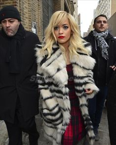 Rita Ora leaves the DKNY fashion show in a black and white fur coat