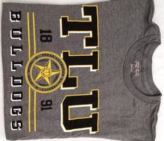 Ace T-Shirt   TLU Bookstore-Possible first prize for a well wisher. Have Max draw an envelope from the wishing well and announce the well wisher as the winner.
