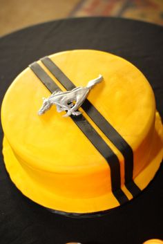 Mustang grooms cake...love the detail in the mustang emblem