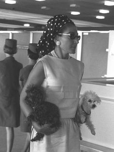 Maria holding her two favorite dogs at Orly airport in Paris on January 9, 1966