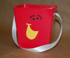 Pail favor box or find a red bucket and do the face on that