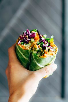 Detox Rainbow Roll-Ups - with curry hummus and veggies in a collard leaf, dunked in peanut sauce! most beautiful healthy desk lunch! #glutenfree #sugarfree #vegan #vegetarian #healthy #cleaneating #recipe | pinchofyum.com