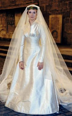 """Julie Andrews is a beautiful bride, in a beautiful, simple gown. 'Maria's"""" wedding gown in THE SOUND OF MUSIC. The American couturier Main Rousseau Bocher This white satin gown is so simple! No lace or embellishment of any kind. Movie Wedding Dresses, Wedding Movies, Wedding Gowns, Famous Wedding Dresses, Modest Wedding, Dream Wedding, Wedding Day, Wedding Scene, Simple Gowns"""