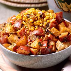 Spicy Potato Salad - Ingredients: 4 large round red potatoes(about 2 pounds) 1/3 cup vegetable oil 1/4 cup white vinegar 1 tablespoon sugar 1 1/2 teaspoons chili powder 1 teaspoon seasoned salt 1/8 teaspoon hot sauce 1 (8 3/4-ounce) can whole kernel corn, drained  1 small carrot, shredded  1 (2.5-ounce) can sliced ripe olives 4 green onions, sliced