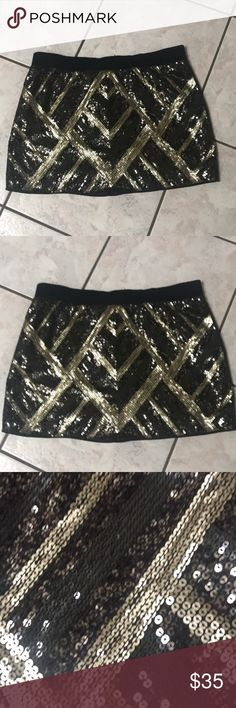 NWOT sequined mini skirt by authentic icon - MY COUSIN BOUGHT THIS SKIRT AND NEVER WORE IT!! It's in perfect condition all sequins in place- gold black and metallic colored sequins- back is dark gray silk with fantastic gold zipper going up back- THIS IS A TRUE DEAL !! Please do not low ball- GREAT SKIRT THAT CAN BE WORN SO MANY DIFFERENT WAYS - casual with boots and a sweater or put on some high heels and a silky cami and go out on the town! AUTHENTIC ICON Skirts Mini