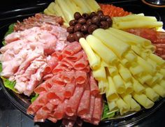 Large colorful meat and cheese tray