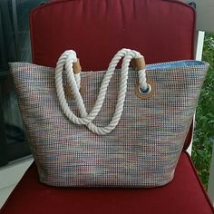 Huge DISCOUNT  Multi color weaved bag     HUGE DISCOUNT!     Multi color large bag, weave stitched. Interior is a pretty light blue. Inside pockets and zipper pocket.  Snap closure. Cream rope handles with silver hardware and tan leather accents....  Love this bag and at an incredible price!                            Four available!    Bags